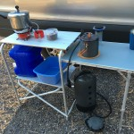 outdoor camp table, Helio pressure washer at the ready underneath