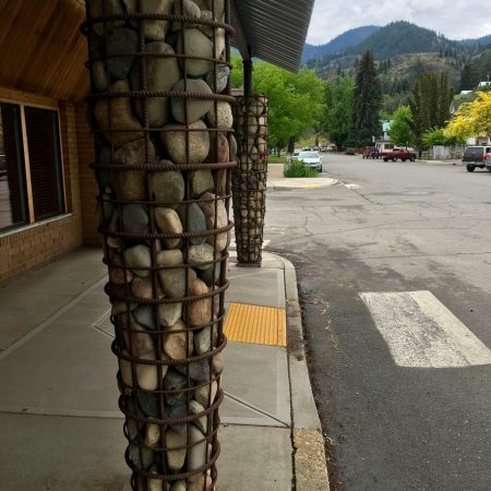 Unusual gabion basket column made from rebar at a Twisp storefront.