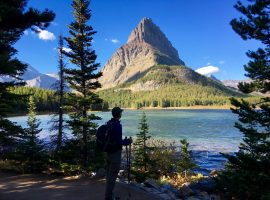 Stopping for a moment along the shore of Swiftcurrent Lake